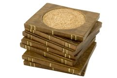 Wooden Coasters. Stack of brown, wooden drink coasters Royalty Free Stock Photography