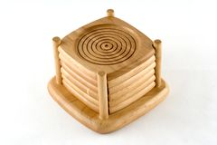 Wooden coasters. Coasters stacked in their holder Stock Image