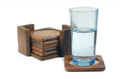 Wooden coasters and wet glass Royalty Free Stock Images