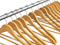 Wooden coat hangers on clothes rail Stock Photography