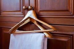Wooden coat hangers Stock Images