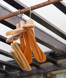 Wood Coat Hangers on Rustic Clothes Rack Royalty Free Stock Images