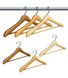 Wooden coat hangers on the tube for wardrobe clothes Royalty Free Stock Photo