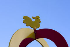Wooden cockerel on the sky background Royalty Free Stock Image