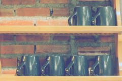 Wooden coffee cup shelf Royalty Free Stock Images
