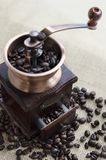 Wooden coffee grinder and coffee beans royalty free stock photo
