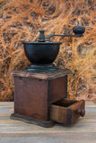 Wooden coffee grinder. Manual wooden coffee grinder. Beautiful decoration of your kitchen Stock Photography