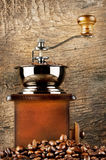 Wooden coffee grinder with roasted coffee beans Royalty Free Stock Photos