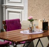 Wooden Coffee Table and Chair, with Rose flower and Blanket, outside in a sunny summer day stock photos