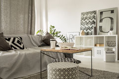 Wooden coffee table in modern lounge Stock Photos