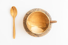 Wooden coffee or tea cup with wooden spoon in top view, isolated Royalty Free Stock Images