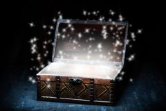 Wooden coffer with white sparkling lights Royalty Free Stock Images