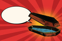 Wooden coffin says comic bubble Royalty Free Stock Image