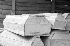 Wooden coffins of various sizes / black and white photo Royalty Free Stock Image
