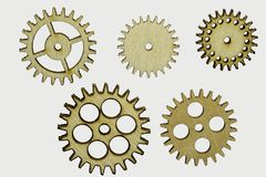 Wooden cog wheels isolated. Set of five different wooden cog wheels isolated on white background Royalty Free Stock Photos