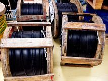 Wooden coil of electric and Fiber optic cable Stock Photos