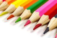 Wooden color pencils closeup, view at an angle Royalty Free Stock Photos