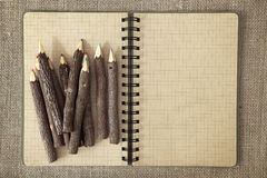 Wooden color pencils and exercise book Royalty Free Stock Photography