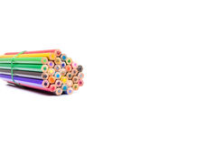 Wooden color pencils with a rubber band out on white background Royalty Free Stock Photography