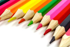 Wooden color pencils on white background closeup, placed by a semicircle Royalty Free Stock Photography