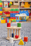 Wooden color toy. Sorter. Wooden color toy in room for children Royalty Free Stock Images
