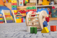 Wooden color toy. Sorter. Wooden color toy in room for children Stock Photo