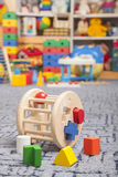 Wooden color toy. Sorter. Wooden color toy in room for children Stock Image
