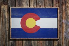 Wooden Colorado flag. 3d rendering of a Colorado State USA flag on a wooden frame and a wood wall Royalty Free Stock Photo