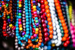 Wooden colored beads on display on the market in Zakopane, Poland Royalty Free Stock Photo