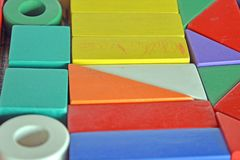 Wooden constructions for children play. Wooden colored blocks, construction game, part of a series, closeup Royalty Free Stock Images