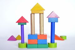 Wooden constructions for children play. Wooden colored blocks, construction game, part of a series, closeup Stock Photo