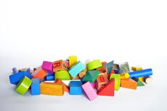 Wooden constructions for children play. Wooden colored blocks, construction game, part of a series, closeup Royalty Free Stock Image