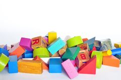 Wooden constructions for children play. Wooden colored blocks, construction game, part of a series, closeup Stock Photos