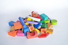 Wooden constructions for children play. Wooden colored blocks, construction game, part of a series, closeup Royalty Free Stock Photos