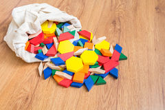 Wooden colored blocks poured out of bag Shallow DOF. Colorful, tree, game, blocks, toy, math Royalty Free Stock Photography