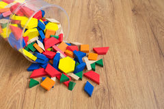 Wooden colored blocks poured out of box. Shallow DOF. Colorful, tree, game, blocks, toy, math Royalty Free Stock Photo