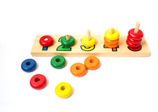 Wooden colored blocks, rings. Game for learning account.Shallow. Blocks, rings, colorful, tree, game, isolate,math Royalty Free Stock Images