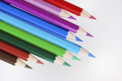 Wooden colored crayons Royalty Free Stock Images