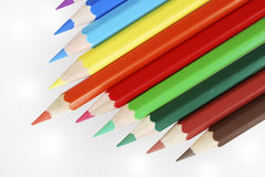 Wooden colored crayons Royalty Free Stock Photos