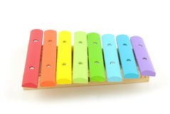Wooden colored xylophone. Isolated on white background royalty free stock photography