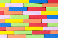 Wooden colorful blocks, aligned. Textured background Stock Images