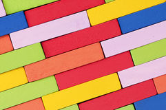 Wooden colorful blocks, aligned. Textured background Stock Image