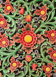Wooden colorful floral carving decorative panel Textural background. Royalty Free Stock Photography