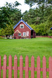 Wooden colorful house well fence rural homestead. Wooden colorful house in rural homestead. Well. Fence. Green lawn yard Royalty Free Stock Photos