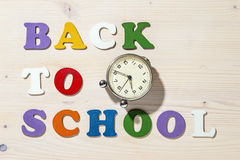 Wooden Colorful Letters Spelling Back To School With Old Clock Royalty Free Stock Image