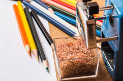 Wooden colorful pencils. With sharning shavings Royalty Free Stock Photos