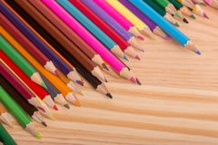 Colorful pencils. Wooden colorful pencils, on wooden table stock photo