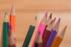 Colorful pencils. Wooden colorful pencils, on wooden table royalty free stock photos