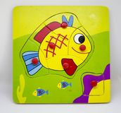 Wooden fish puzzle. Wooden colorful puzzle with fish for toddler Stock Images