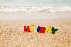 Wooden colorful word 'Holiday' Stock Images